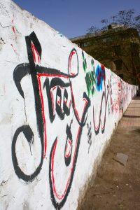 street art rebellious revolution Tripoli graffiti: revolution street art in libya  shafshoufa, a nickname given to  gadafi for his unruly hair (i think), part of a call 'maaleshi,.