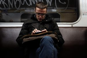 A man reading the news on his phone.