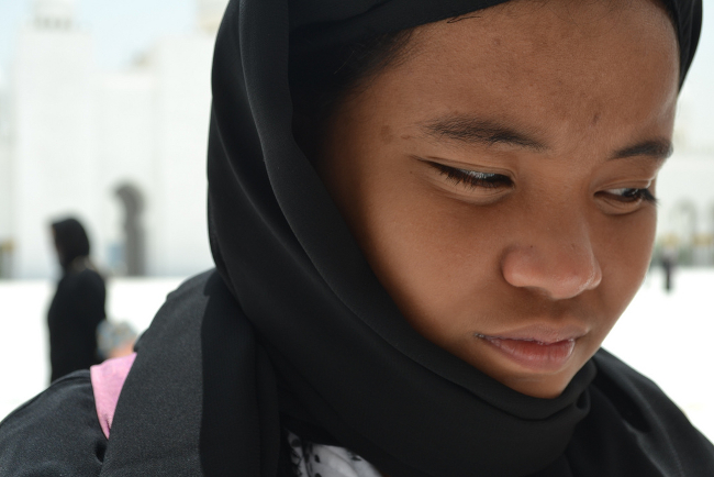 A closeup of a woman in traditional abaya.