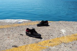 Two shoes on a dock.