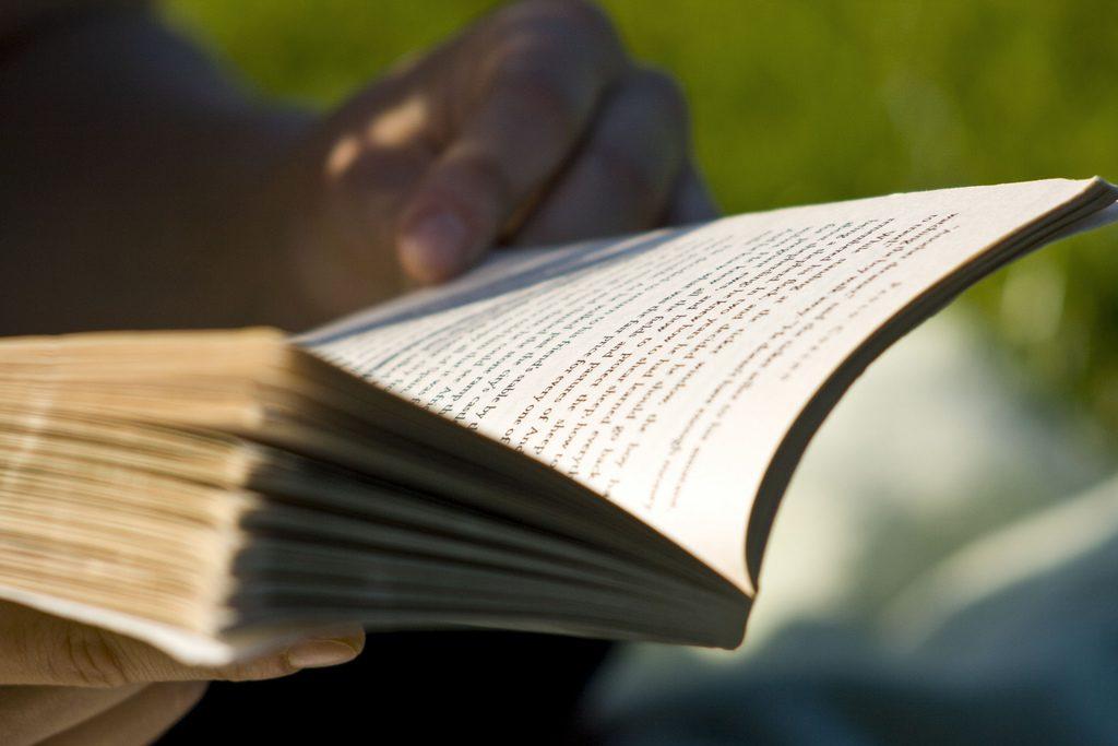 A person reading in the sun.