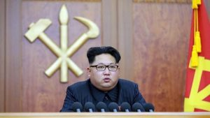 North Korean leader Kim Jong-Un speaking at a podium.