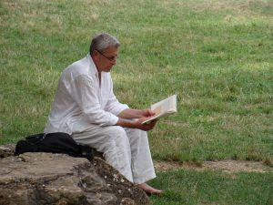 A man reading on a lawn