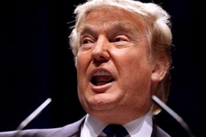 Donald Trump speaking at an event, face contorted as he talks.