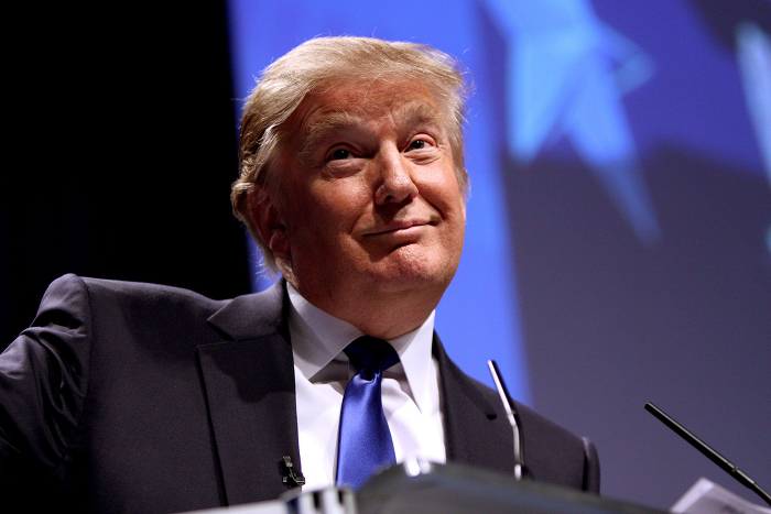 Republican presidential candidate Donald Trump, with a contorted expression on his face.