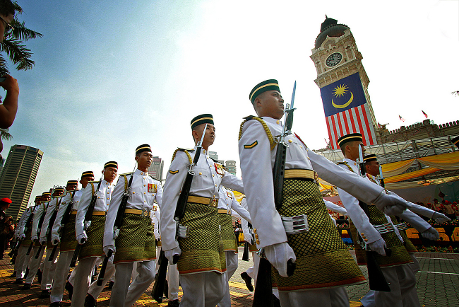 Members of the Malaysian military marching in formation at an event