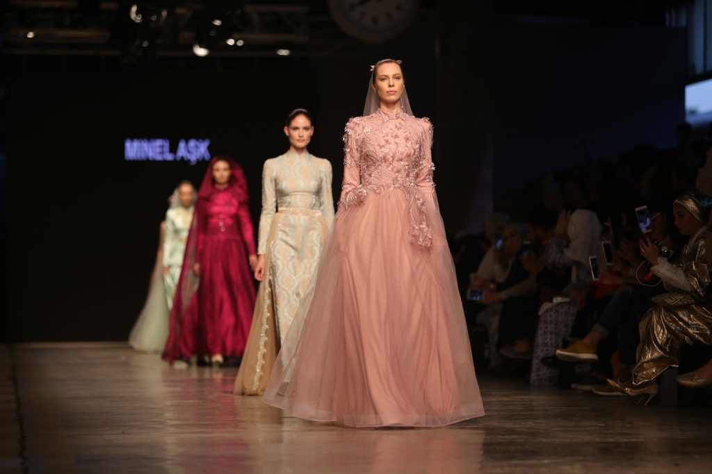 Women wearing stunning ballgowns with modest styling.