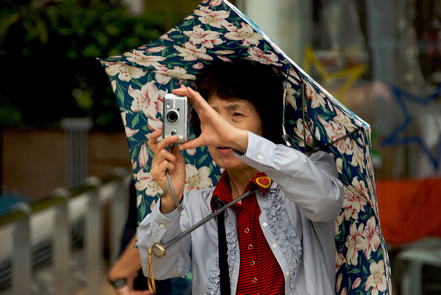 A tourist taking a photograph in Kowloon.