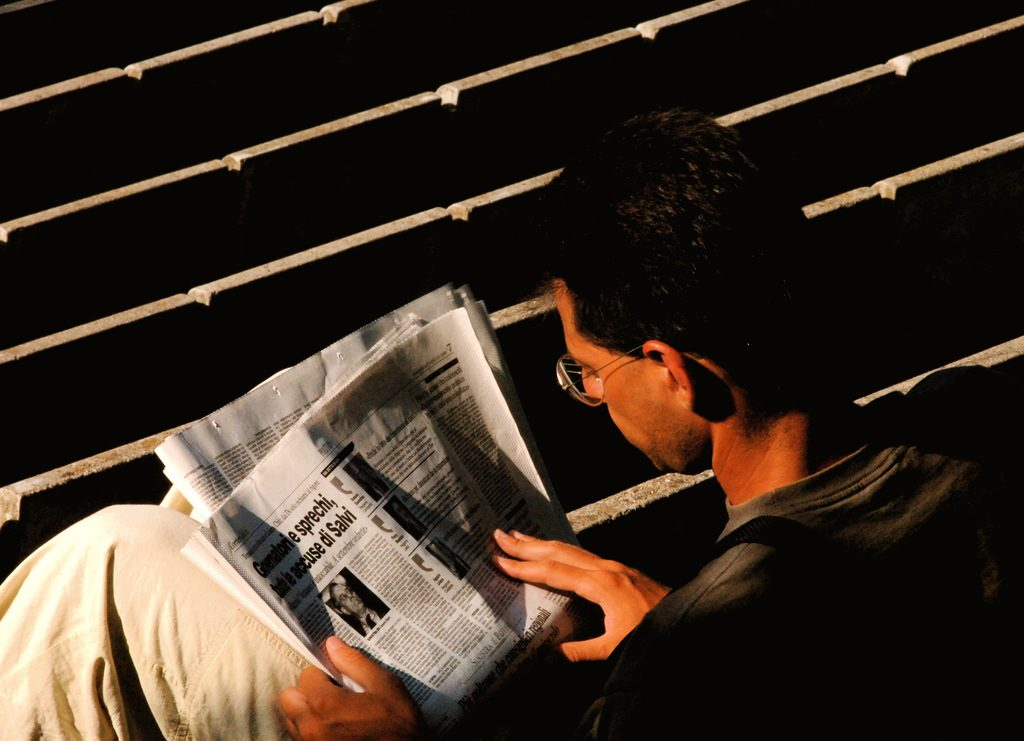 A person reading a paper.