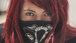 A defiant woman in a bandana.