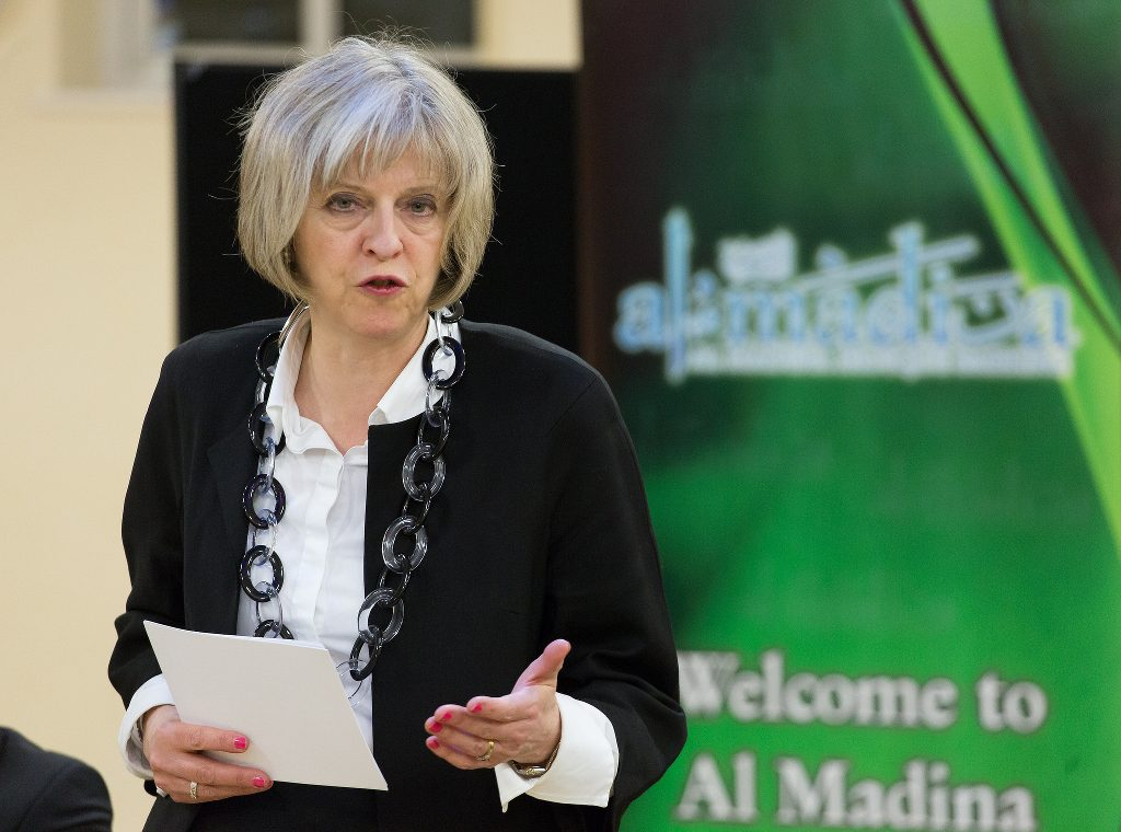 Theresa May speaking at an event.