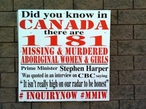 A sign raising awareness about thousands of missing women in Canada and the PM's indifference.