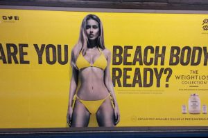 An ad featuring a woman in a bikini asking if the viewer is beach body ready.