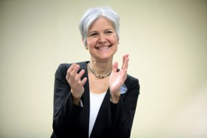 Politician Jill Stein, smiling and clapping.