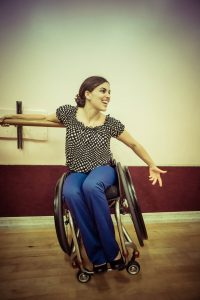 Sam de Leve dancing in their lightweight, properly fitted, easily-controlled wheelchair.