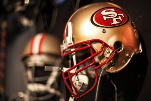 A row of 49ers football helmets.