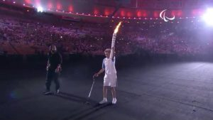 Athlete Marcia Malsar carrying the torch during the opening ceremonies of the 2016 Paralympics.
