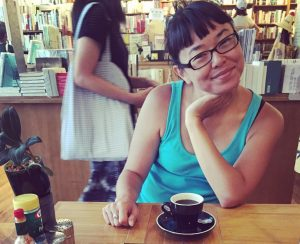 Louise Hung in a cafe.