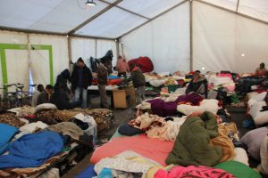 People crowded into a shelter in the Calais Jungle refugee camp.