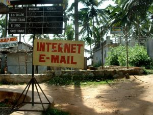 A sign advertising internet and email.