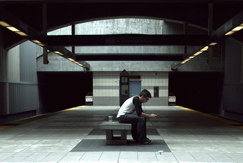 A person reading alone in a BART station.