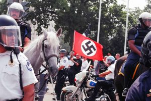 Neonazis surrounded by police horses.
