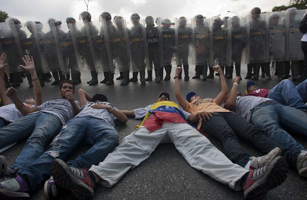 Protesters lying in the street in Venezuela.