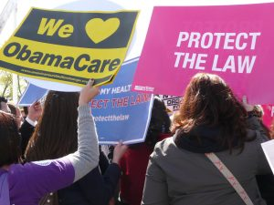 Protesters appearing in support of the Affordable Care Act.