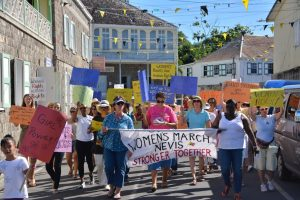 Participants in the Nevis Women's March, most of whom are white.
