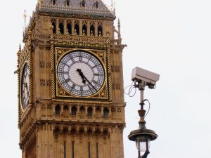 A surveillance camera, with Big Ben in the background.