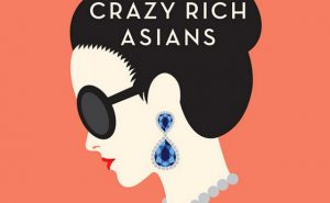 The cover of Crazy Rich Asians, featuring a drawing of an Asian woman in sunglasses with huge earrings.
