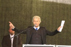 Geert Wilders speaking at an event.