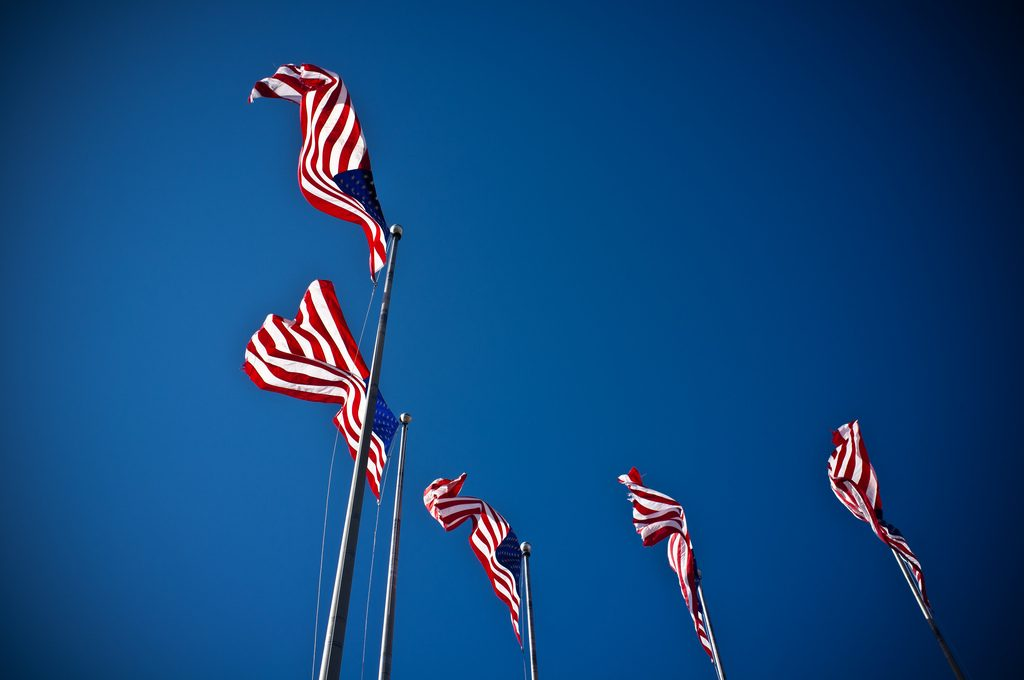 US Flags waving on a sunny day.