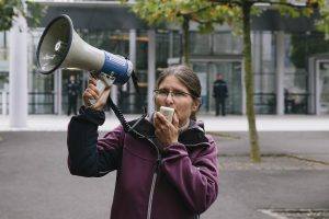 A person speaking into a megaphone