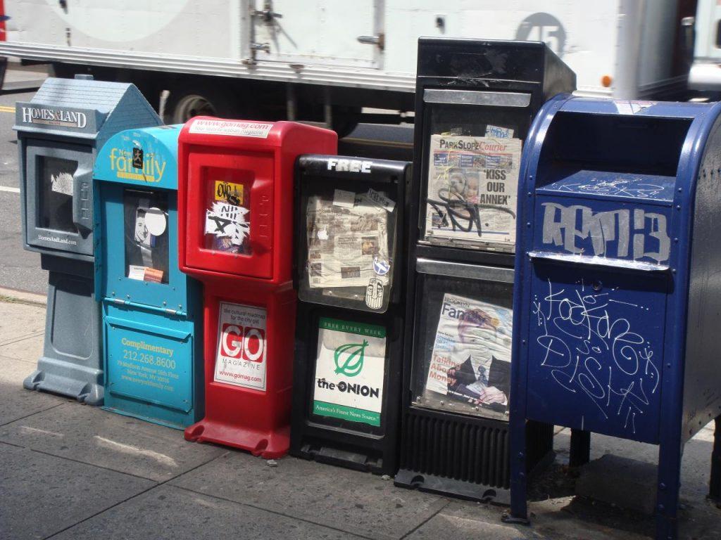 A row of newspaper racks.