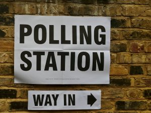 A sign indicating the way to a polling station