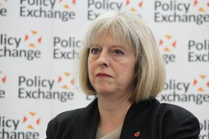 Theresa May, a white woman with greying hair, looking exasperated.