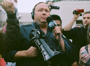 Alex Jones carrying a bullhorn
