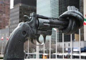 A statue of a gun, barrel tied in a knot