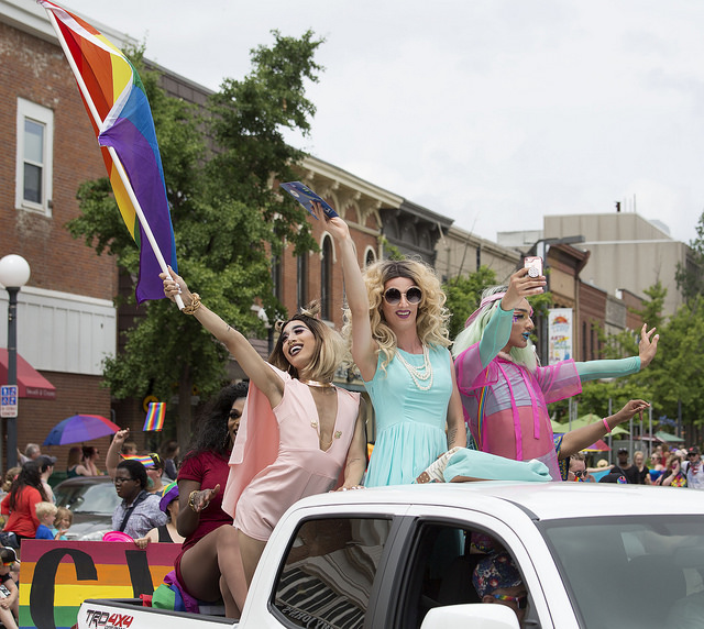 Drag queens on a pride float.