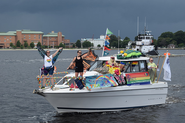 Pride celebrants in a boat.