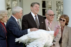 Ronald Reagan posing at a ceremonial turkey pardoning.