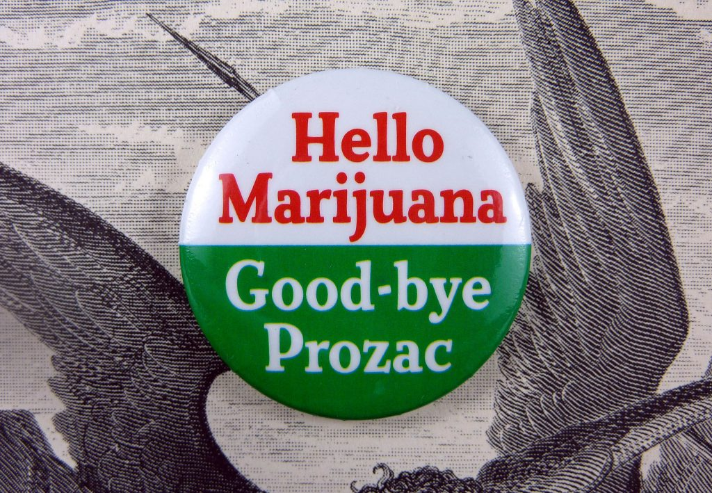 A button reading HELLO MARIJUANA GOODBYE PROZAC