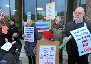 Protesters expressing concern about cuts to disability services