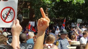 Counterdemonstrators flipping off KKK members in Charlottesville