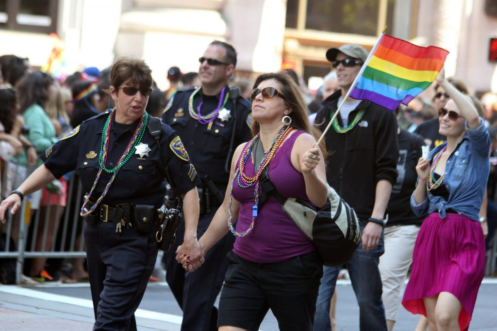 Police officers marching in a pride parade