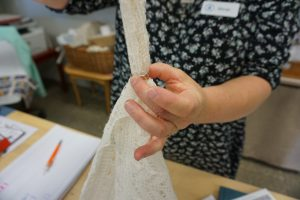 Pulling Lace Through a Wedding Ring in Haapsalu