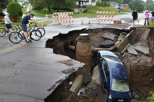 A car falling into a sinkhole.
