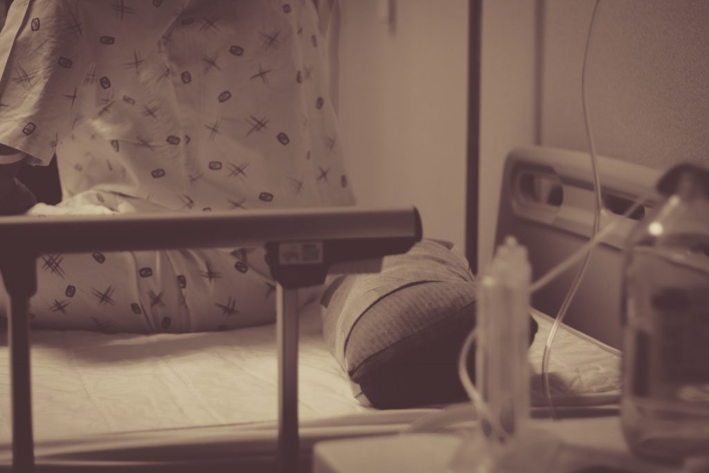 A person sitting in a hospital bed