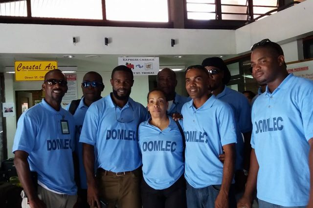 A group of men wearing Domlec shirts